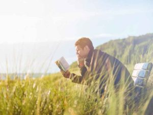 Picture of a man reading a book